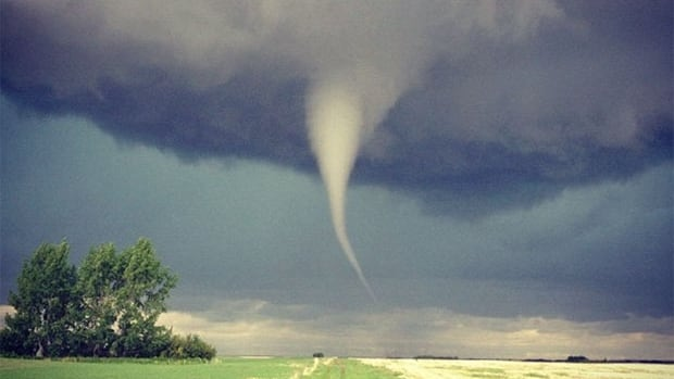 If a funnel cloud is a rotating column extending from the base of a cloud. It is not a tornado until it touches the ground. This funnel cloud was spotted near Wilkie, Sask., in 2012.
