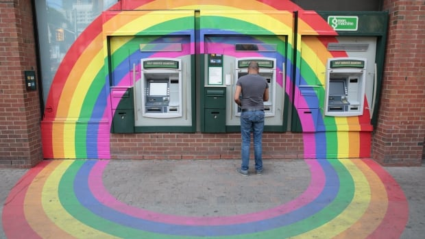 A gay pride rainbow surrounds a bank ATM in Toronto's Church and Wellesley gay village district.