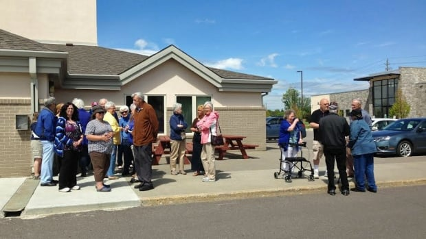 A group of seniors and other community members gathered Thursday outside the West Thunder Community Centre to find out why the centre's cafe was suddenly closed.