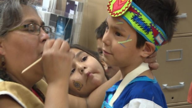 A youngster gets ready for a National Aboriginal Day event at The Circle Project in Regina Friday. Some events were held in advance of June 21, the official date for NAD.