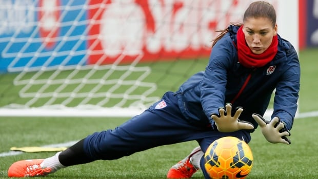 U.S. goalkeeper Hope Solo makes a save at practice in Winnipeg on May 7, 2014, during a practice in preparation for their friendly match against Canada. Solo was arrested early Saturday morning for investigation of two counts of fourth-degree domestic violence assault and booked into jail.