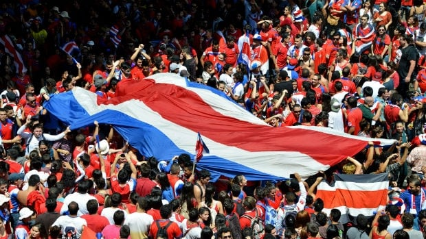 Costa Rican fans celebrate in San Jose after defeating Italy 1-0 at the World Cup to reach the Round of 16.