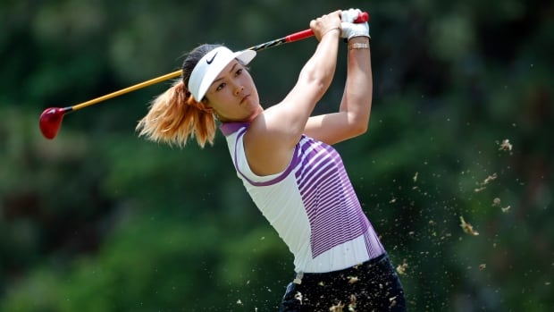 Michelle Wie watches her tee shot on the second hole during the third round of the U.S. Women's Open golf tournament in Pinehurst, N.C., on Saturday.