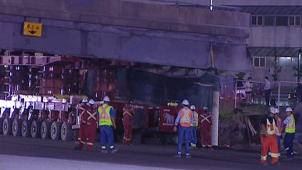 Construction workers pulled an overnight shift to remove the Lees Avenue overpass.
