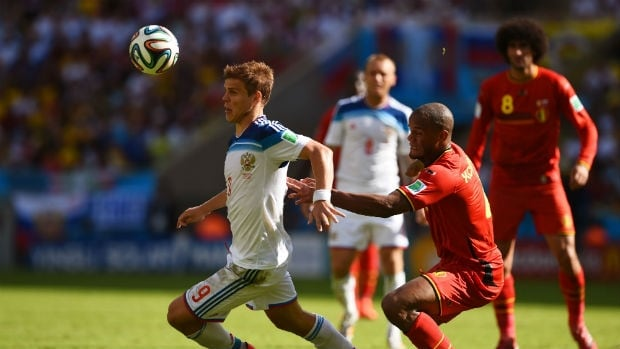 Alexander Kokorin of Russia, left, controls the ball during the team's match against Belgium at the 2014 FIFA World Cup.