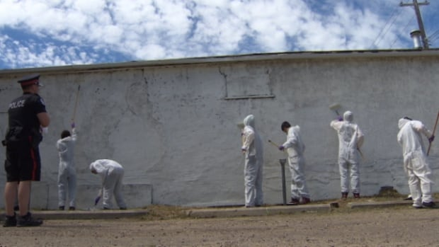 Several youth were working off vandalism-related crimes they've received by cleaning up graffiti Saturday.