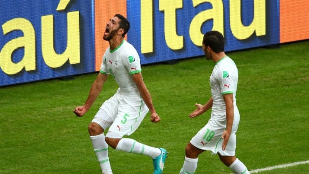 Rafik Halliche of Algeria, left, celebrates after scoring his team's second goal against South Korea during a match at the 2014 FIFA World Cup.