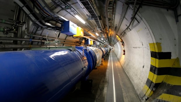 The Large Hadron Collider, pictured in 2007, sits in its 27-kilometre tunnel at CERN (European particle physics laboratory) near Geneva, Switzerland. The collider is being improved and is set to resume early next year at double its former energy level.