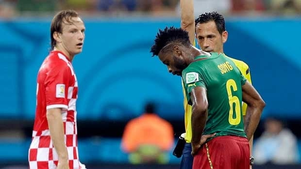 Alex Song is shown being banished from the Cameroon-Croatia match on June 18.