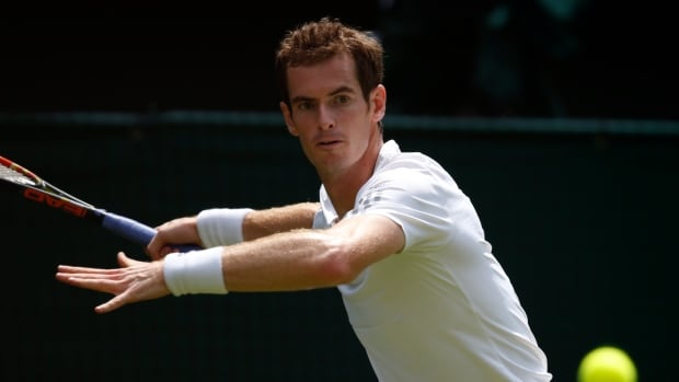 Andy Murray of Britain plays a return to David Goffin of Belgium during their first round match at the All England Lawn Tennis Championships on Monday.