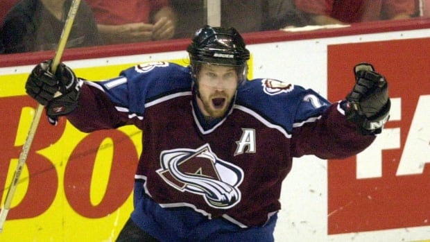 Colorado Avalanche centre Peter Forsberg is shown celebrating a 2002 playoff goal.