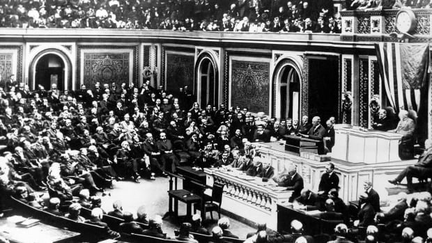 "President Woodrow Wilson delivers a speech to the joint session of Congress in Washington on April 2, 1917. Wilson had been re-elected in November 1916 on the slogan ""he kept us out of war,"" but had a change of heart and authorized the creation of the Committee on Public Information to fire up a reluctant American population."