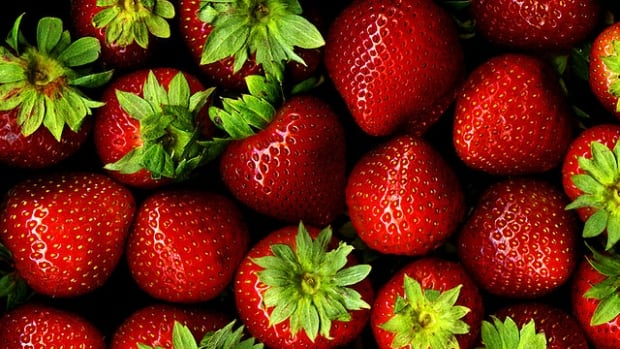 Discounted strawberries from California hit produce shelves as Canadian berries are ready to be sold.