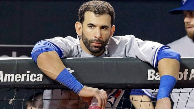 "Blue Jays manager John Gibbons says he is hopeful that right-fielder Jose Bautista, pictured here, would only miss ""a couple of days"" with a mild left hamstring strain. He left Sunday's 4-3 loss in Cincinnati after pulling up lame while running to second base on a sacrifice bunt."