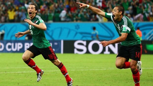 Andres Guardado, left, and teammate Javier Hernandez celebrate their team's second goal against Croatia Monday in Recife, Brazil.