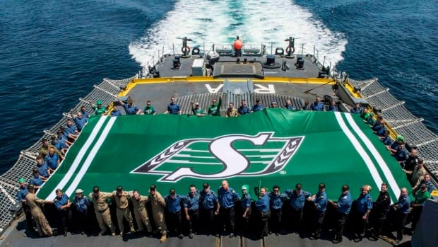 The Roughriders team flag was unfurled on the HMCS Regina.