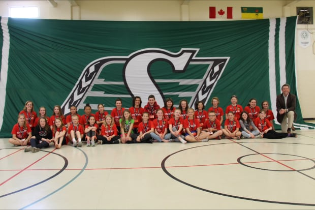 students with the roughriders flag