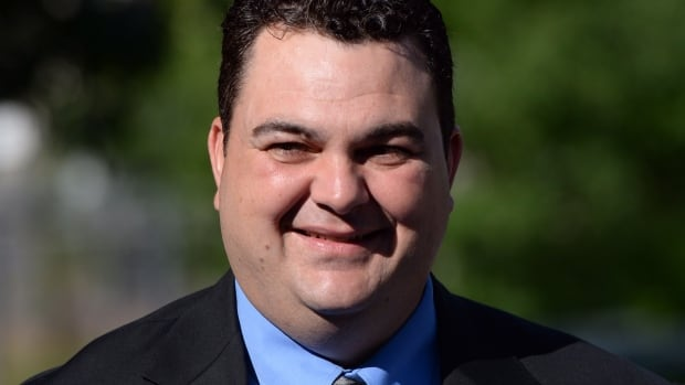Former Tory MP Dean Del Mastro arrives at court in Peterborough, Ont. on Monday, to stand trial for campaign overspending in 2008.