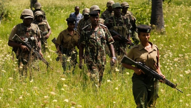 Kenyan police officers patrol Mavuno villages near Mpeketoni after an attack on June 17 that left more than 60 dead. Officials confirmed Tuesday that the town had been attacked again, killing 5, but it was unclear who carried out the assault.