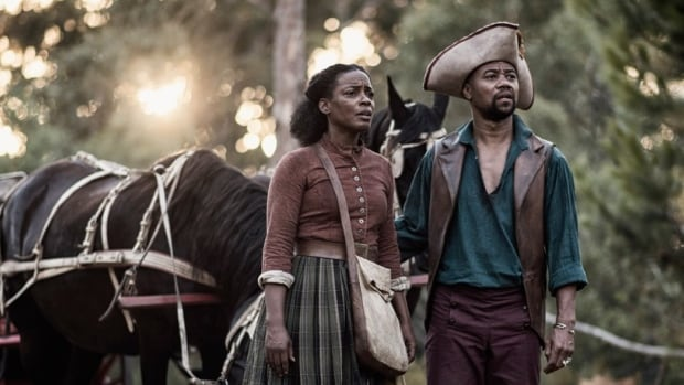 Actors Aunjanue Ellis (left) and Cuba Gooding Jr. appear in a scene from The Book of Negroes.