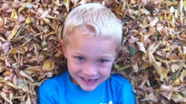 """Thomas Wedman, 6, was struck and killed by a school bus last September. """"We miss him more than we ever would have thought possible,"""" his father Jeff said in a written statement."""