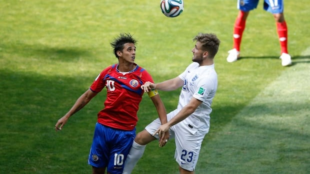 Costa Rica's Bryan Ruiz and Luke Shaw go for the ball in their final Group stage match at the FIFA World Cup in Brazil.