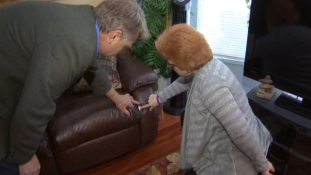 Laurin Clarke shows Go Public's Mark Harvey a ripped seam on a loveseat she purchased from The Brick.