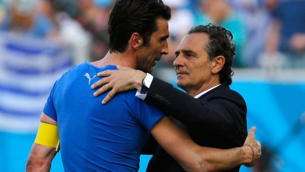 Italy coach Cesare Prandelli, right, consoles goalkeeper Gianluigi Buffon after their loss to Uruguay.