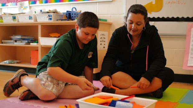 Tanner Mann works out a math problem with Child and Youth Worker Deanna Hurley. In this classroom, students are encouraged to learn at their own pace.