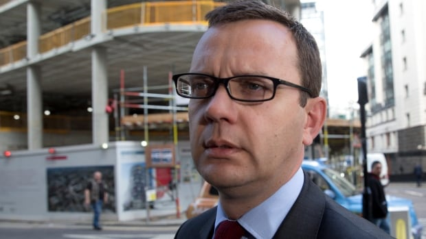 Former News of the World editor Andy Coulson arrives at the Old Bailey courthouse in London today. After a conviction on phone-hacking charges Tuesday, further charges against him and former Royals editor Clive Goodman ended in a hung jury, finishing the trial.