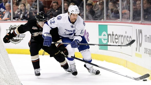Tampa Bay's Ryan Malone, right, battles for the puck during a game in November.