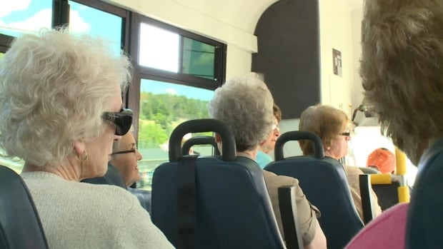 Springdale area residents enjoy a ride on the Care 2 Ride bus.