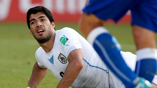 Uruguay's Luis Suarez gets up from the ground during a 2014 World Cup Group D soccer match against Italy at the Dunas arena in Natal.