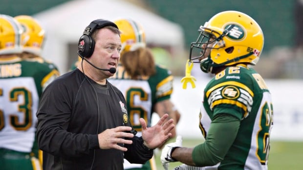 Edmonton Eskimos head coach Chris Jones talks with AJ Guyton during an exhibition game earlier this month.