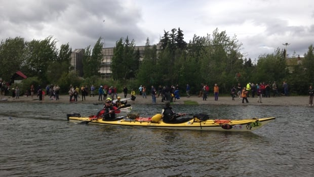 Kayakers depart on the Yukon River Quest from Rotary Peace Park in Whitehorse on Wednesday. Paddlers later ran into rough conditions on Lake Laberge.
