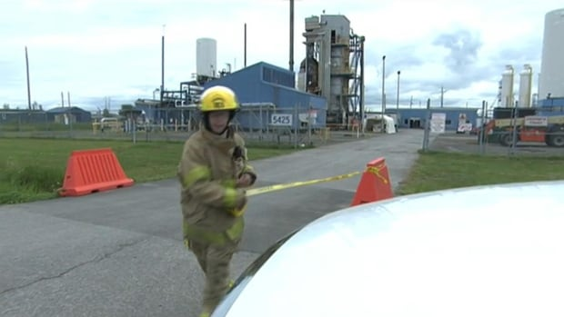 Firefighters were called to Olin manufacturing plant after an explosion sent a yellow cloud of smoke into the sky.