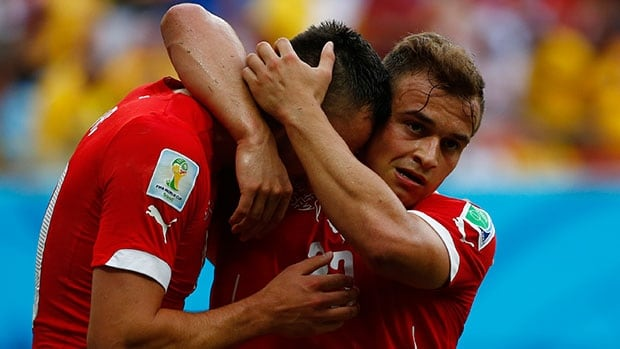 Switzerland's Xherdan Shaqiri, right, celebrates one of his three goals with teammate with Josip Drmic against Honduras Wednesday in Manaus, Brazil.