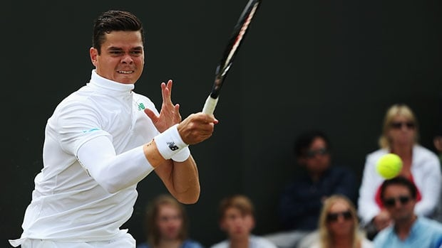 Milos Raonic plays a shot during his second-round win over American Jack Sock at the All England Club.