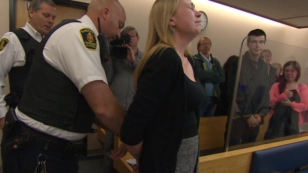 Brenna Gillespie, 20, winced as she was handcuffed Thursday in provincial court in St. John's.