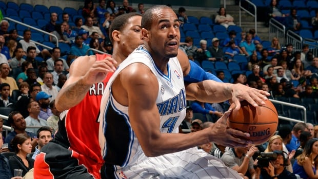 Arron Afflalo, right, averaged 18 points for the Magic in 2013-14. Denver acquired him in a trade Thursday for fellow guard Evan Fournier, who averaged 8.4 points and 1.5 assists this past season.