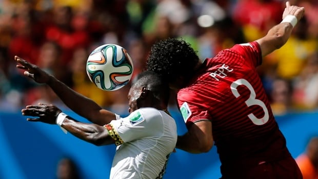 Ghana's Abdul Majeed Waris, left, fights for the ball with Portugal's Pepe during their World Cup Group G soccer match at the Brasilia national stadium in Brasilia on Thursday. (Ueslei Marcelino/Reuters)