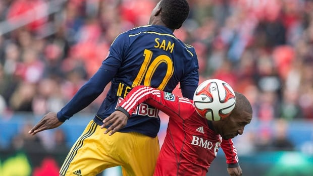 Toronto FC 's Jermain Defoe, right, battles for the ball with the Red Bulls' Lloyd Sam during a May 17 game in Toronto. Manager Ryan Nelsen is expecting New York to give his squad a hard contest as the Red Bulls sit one point behind fourth-place Toronto in the MLS Eastern Conference standings despite having played four more games.