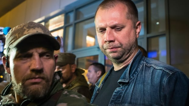 Alexander Borodai, right, prime minister of the self-proclaimed Donetsk People's Republic, called the release of the international monitors 'the fruit of good will.'