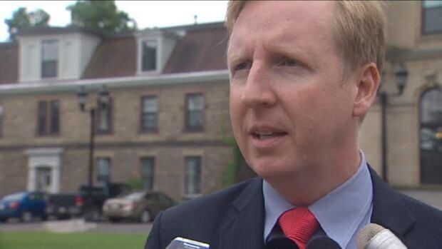 NDP Leader Dominic Cardy speaks outside of the New Brunswick legislature.