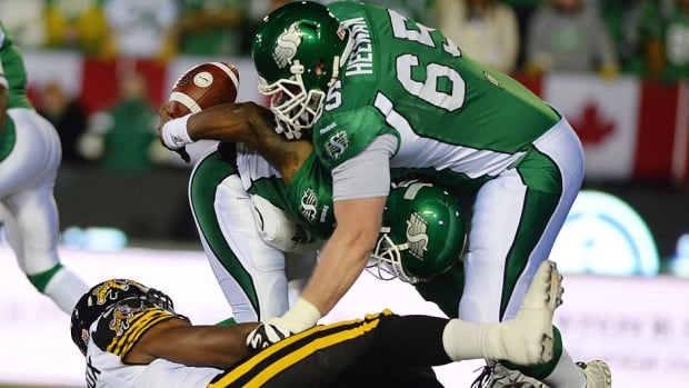 """Ben Heenan, right, is a member of the Roughriders' dependable offensive line that returns for a third consecutive season. """"Those guys don't get a lot of the publicity that a lot of us get, but they're the unsung heroes on this team,"""" says quarterback Darian Durant."""
