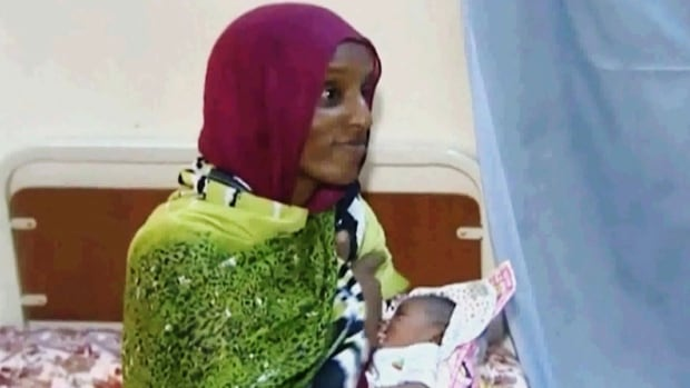 A file image from an undated video shows Meriam Ibrahim with her newborn baby girl, who she gave birth to in jail last week. The Sudanese Christian woman's death sentence for apostasy was overturned and she has now sought safety with the U.S. embassy.