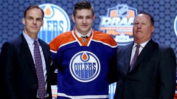 Leon Draisaitl poses with Oilers officials after being selected third overall in the NHL draft at Wells Fargo Center on Friday.