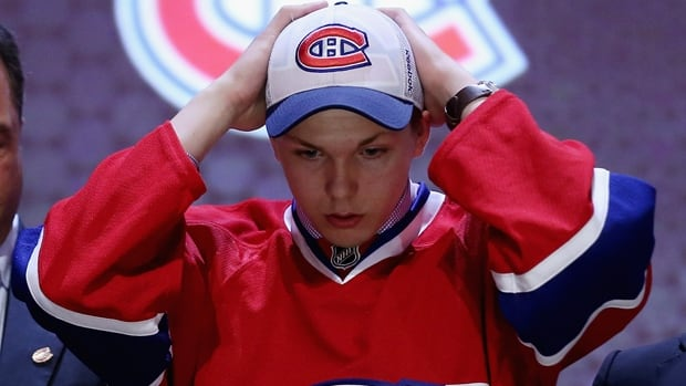Nikita Scherbak adjusts his ballcap after being selected 26th overall by the Canadiens at the NHL draft in Philadelphia on Friday.