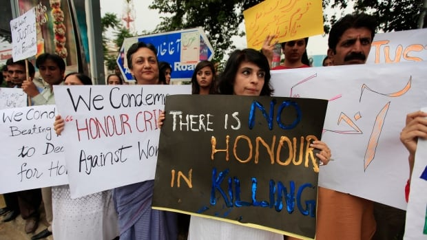 Members of Pakistan's Human Rights Commission protest 'honour killings' in Islamabad last month in response to the killing of a pregnant woman outside a top court in Lahore.