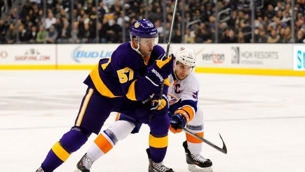Los Angeles Kings right wing Linden Vey battles New York Islanders star John Tavares during a game on Dec. 7, 2013.